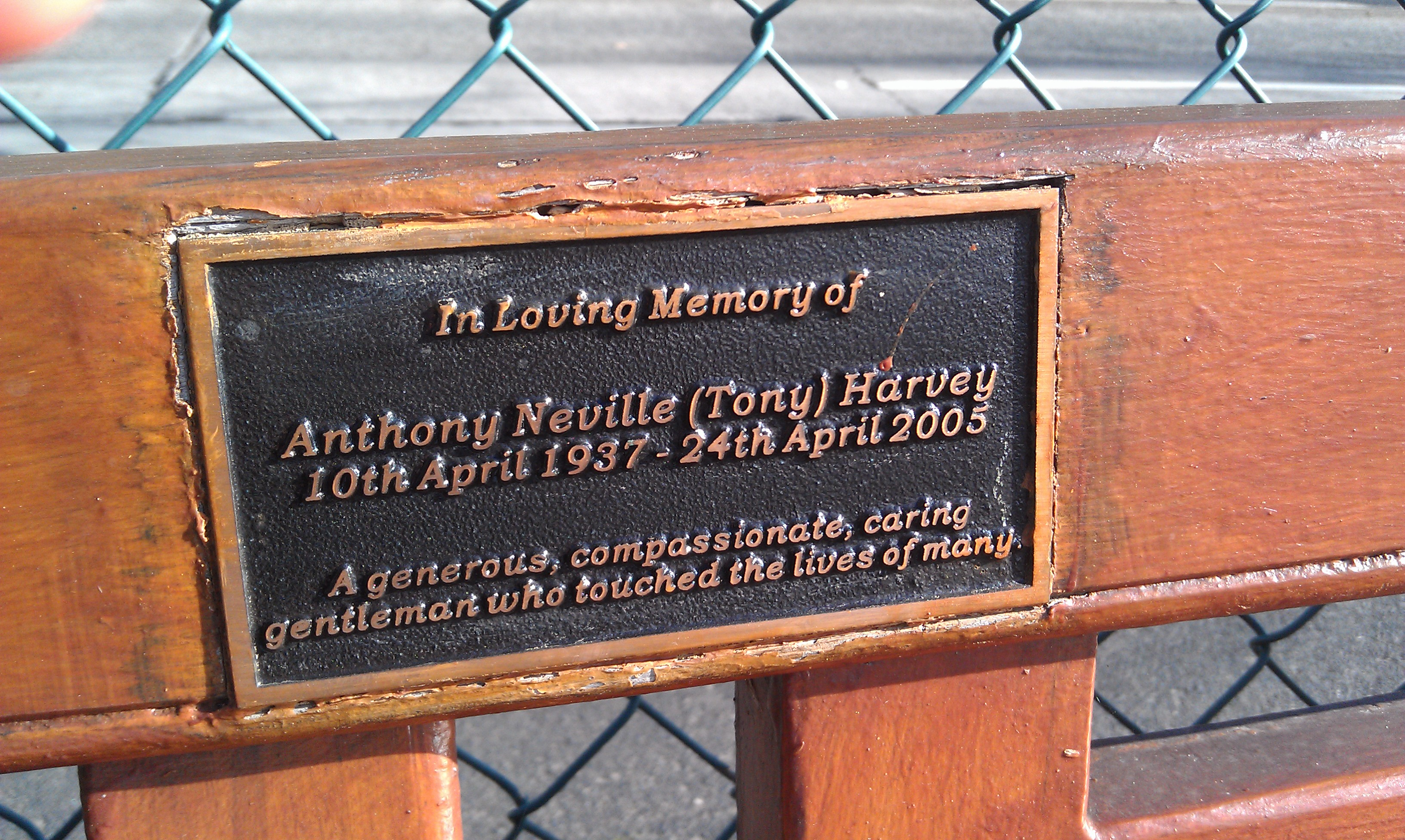 Commemorative plaque on a bench overlooking Sandy Bay, Hobart